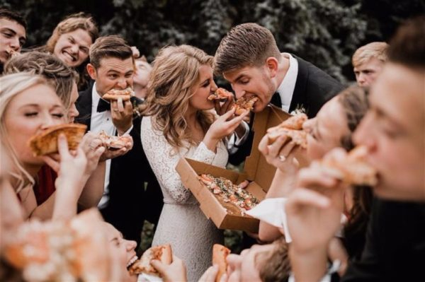 Wedding party eating pizza and having fun